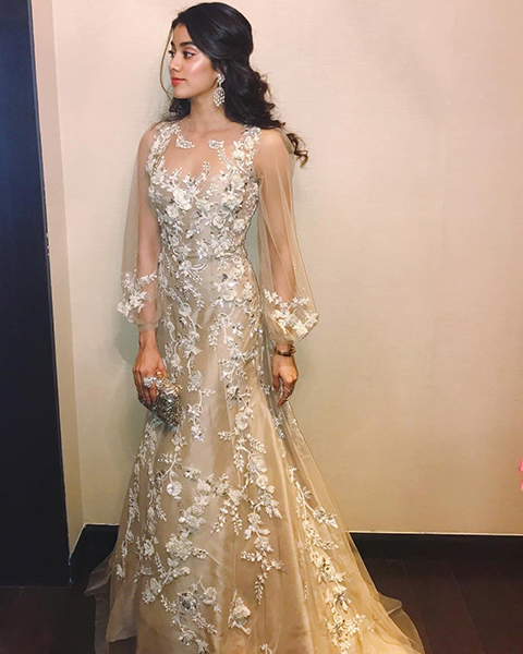 An ivory embroidered gown by Manish Malhotra